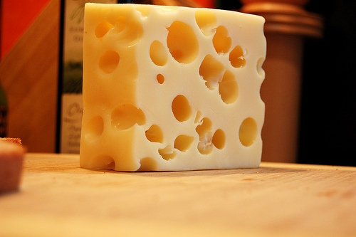 "Emmental Cheese (Swiss) is Made With Mesopholic Culture. The Mesophilic culture is what produces the large ""eyes"" or holes in the cheese."