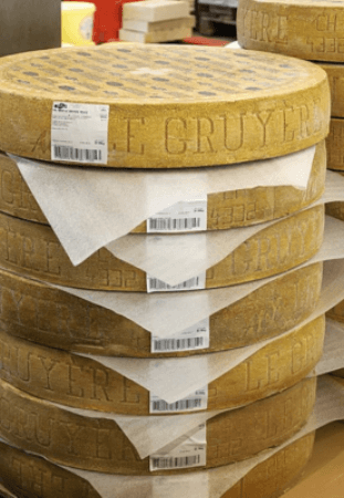 Gruyere Cheese Wheels Stacked