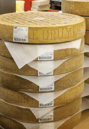 Gruyere Cheese Wheels Stacked
